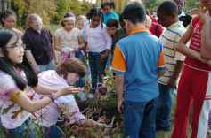 Children_get_instructions_from_teacher_on_how_to_plant_trees_in_their_schooyard